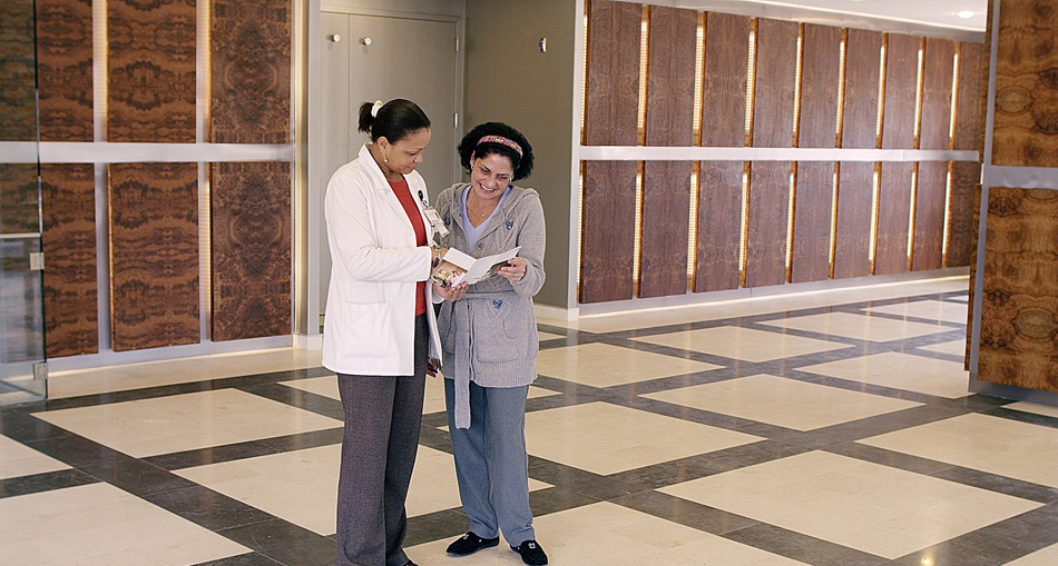 Nurse helping visitor at Momentum