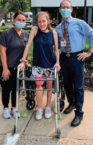 Doctor, physical therapist and patient at Momentum